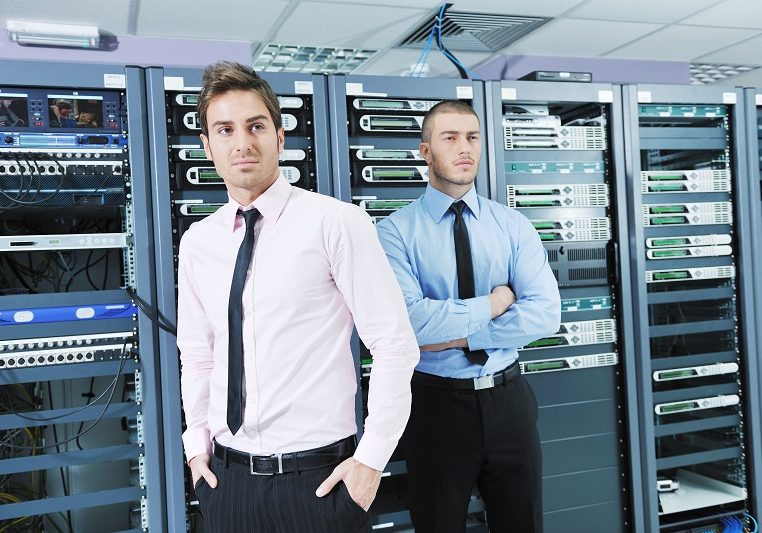 two it engineers in server room